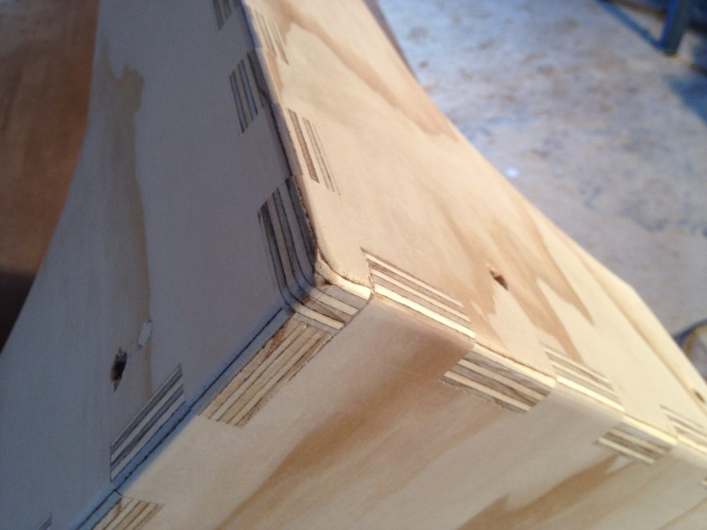 Box jointed column tops, with curved edges shown.